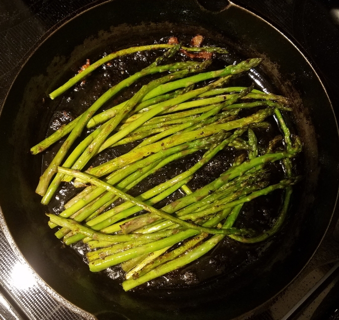 sauteeing the asparagus